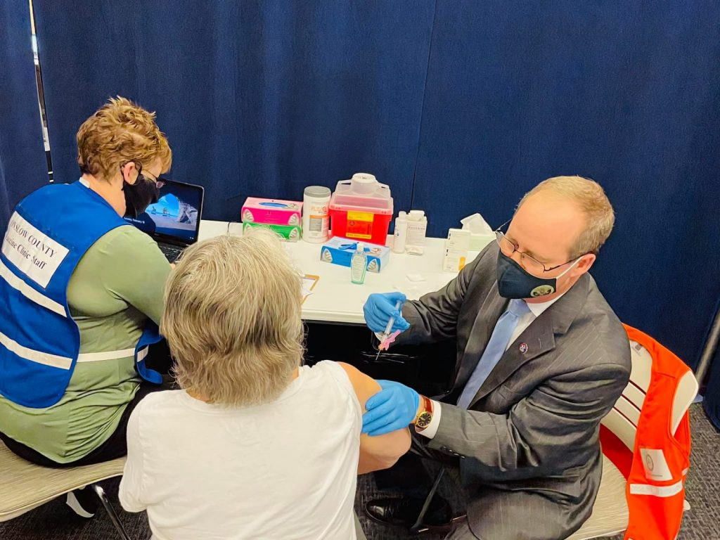 Congressman Murphy, M.D., helps with COVID-19 vaccinations